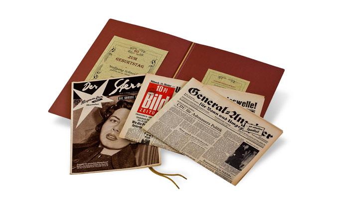 Geschenkmappe mit Zeitungen und Illustrierten